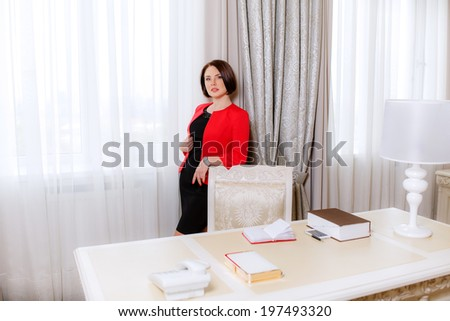 business portrait of a beautiful girl in the interior - stock photo