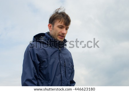 business portrait of a young businessman on background of sky