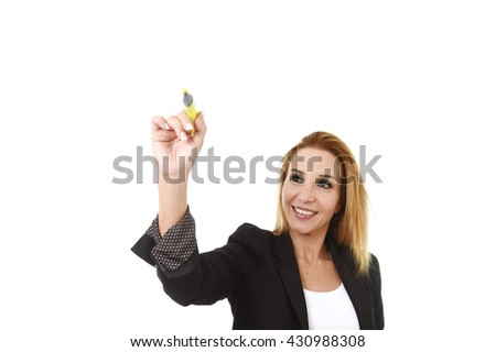 business portrait of attractive blond successful businesswoman holding marker writing or pointing to transparent glassboard screen isolated in white smiling happy and confident with copy space - stock photo