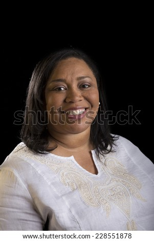 Business portrait of female isolated on black - stock photo