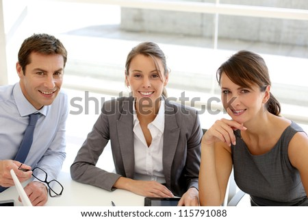 Business presentation around table - stock photo