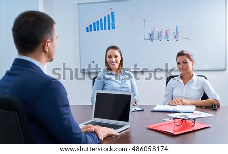 Business presentation on laptop computer in modern office