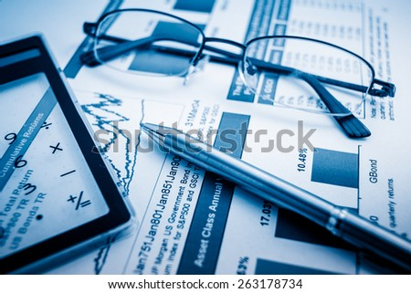 Business presentation with finance  chart on the desk. - stock photo