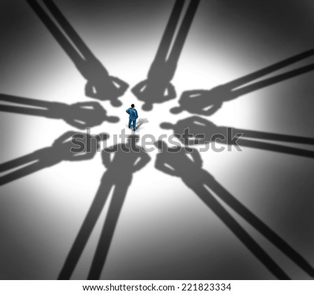 Business pressure and stressed at work as a man standing with a group of cast shadows from company executives as a concept for career interview or feeling the squeeze from businesspeople. - stock photo