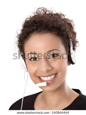 Business: pretty woman wearing headset and smiling at camera isolated on white background - stock photo