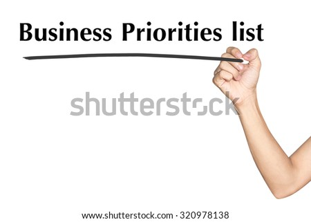 Business Priorities list Man hand writing virtual screen text on white background - stock photo