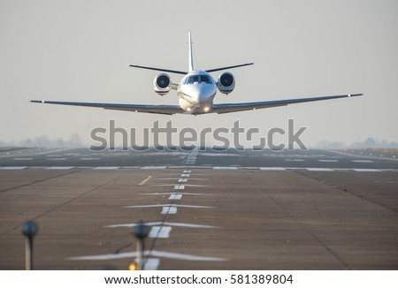 Business private jet in low level flight