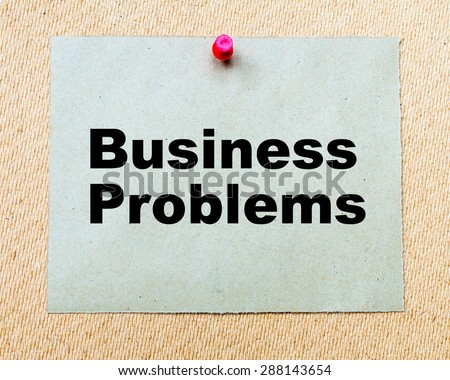 Business Problems  written on paper note pinned with red thumbtack on wooden board. Business conceptual Image - stock photo