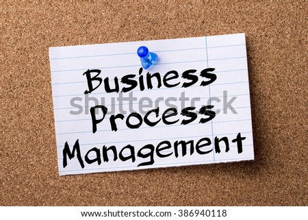 Business Process Management BPM - teared note paper pinned on bulletin board - horizontal image - stock photo