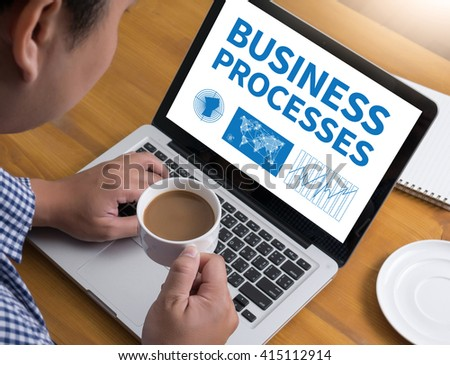 BUSINESS PROCESSES Businessman at work. Close-up top view of man working on laptop while sitting at the wooden desk , coffee - stock photo