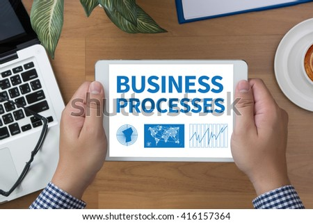 BUSINESS PROCESSES man hand Tablet and coffee cup - stock photo