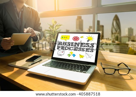 BUSINESS PROCESSES Thoughtful male person looking to the digital tablet screen, laptop screen,Silhouette and filter sun - stock photo