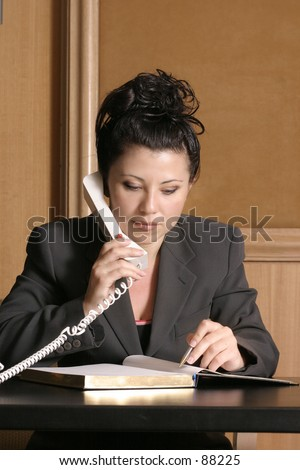 Business professional on phone with schedule/diary
