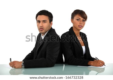 Business professionals at odds - stock photo