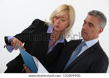 Business professionals discussing a report - stock photo