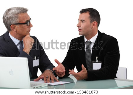 Business professionals having a discussion - stock photo