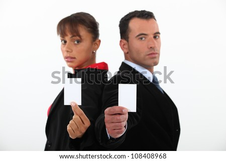Business professionals holding their business cards - stock photo