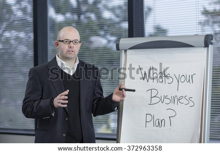 Business Professor leads a brain-storming discussion in a classroom - stock photo