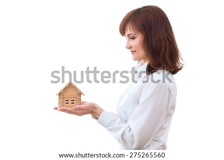 business, real estate and banking concept - smiling businesswoman looking at small house - stock photo