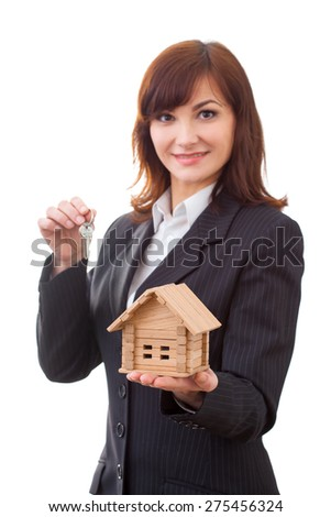 business, real estate and banking concept - smiling businesswoman with house keys and house - stock photo