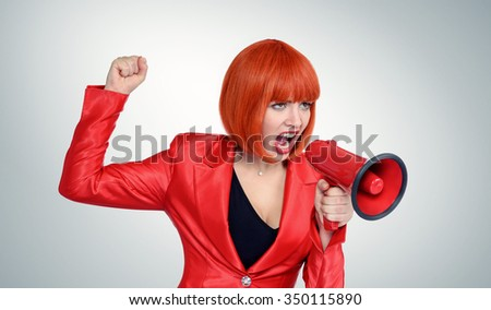 Business redhead woman screaming into a megaphone