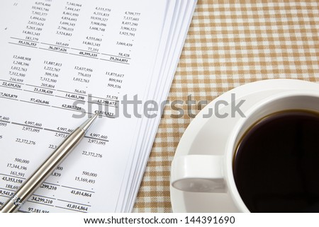 Business report and cup of coffee