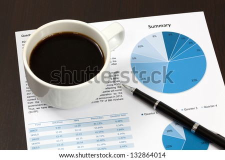 Business report. Cup of coffee on document. - stock photo