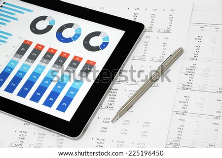 Business Report on Digital Tablet. - stock photo