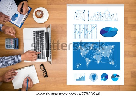 Business Research Data Economy Business Research Data Economy Business team hands at work with financial reports and a laptop - stock photo