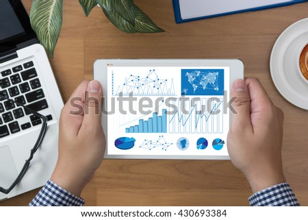 Business Research Data Economy man hand Tablet and coffee cup - stock photo