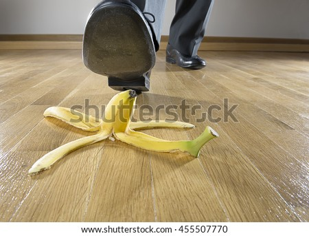 Business risk concept: Man to step on banana skin.  - stock photo