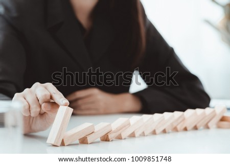 Business risk concept with Blocks of wood game.Businesswoman manage