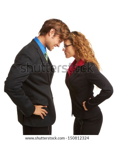 business rivalry competition between business man and woman butting heads isolated on white background. - stock photo