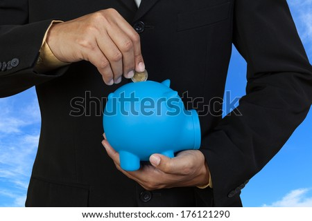 Business saving money on blue sky background - stock photo