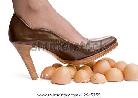 Business sayings, walking on eggshells - stock photo