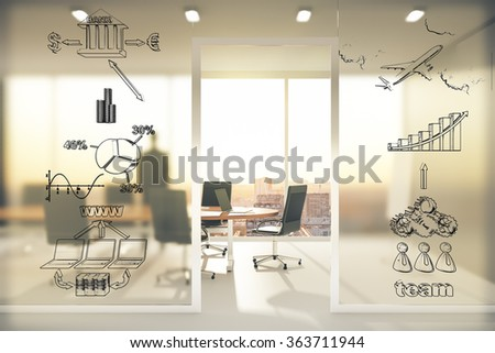 Business scheme concept on transparent wall in conference room at sunset - stock photo