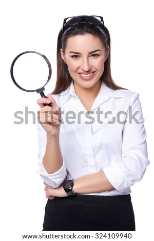 Business search concept. Smiling happy business woman holding magnifying glass, isolated over white - stock photo