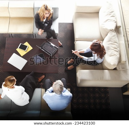 Business seminar at office. Group of business people working together. - stock photo