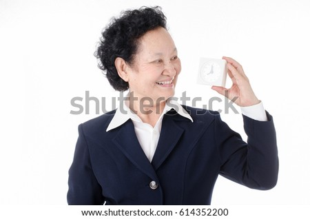 Business Senior woman holding alarm clock over white background