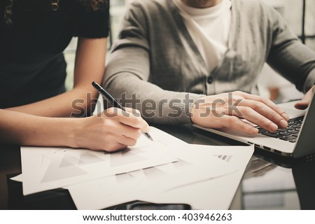 Business situation, signs contracts. Closeup photo finance manager working modern office with new business project. Using laptop,startup idea,team work. Horizontal. Blurred background,film effect