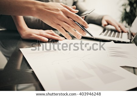 Business situation,team work,brainstorming.Photo account managers working modern office with new business project.Using laptop, discussion startup,colsultation colleague.Horizontal.Blurred,film effect - stock photo