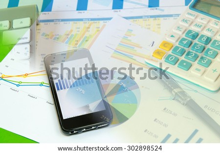 business smart phone and pen on desk.business Concept