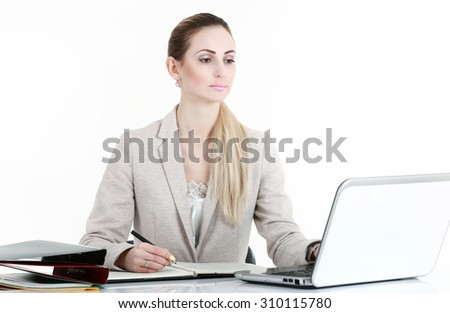 Business smiling woman working on laptop at office  - stock photo