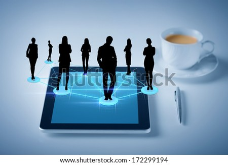 business, social and technology concept - tablet pc with cup of coffee and social or business network - stock photo