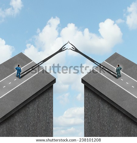 Business solution concept as a metaphor to overcome problems as bridging the gap between two financial partners as cast shadows overcoming obstacles to join together. - stock photo
