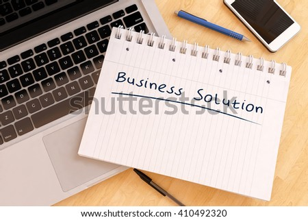 Business Solution - handwritten text in a notebook on a desk - 3d render illustration. - stock photo