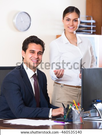 Business specialist and secretary working in modern office  - stock photo