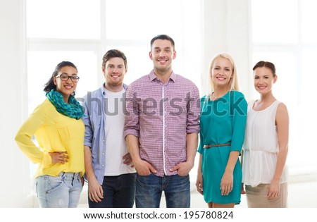 business, startup and office concept - happy business team in office - stock photo
