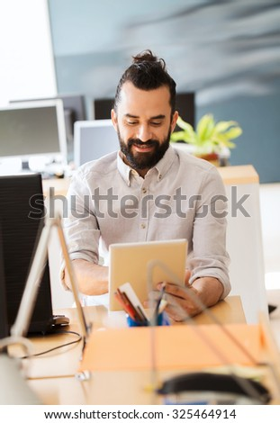 business, startup and people concept - happy businessman or creative male office worker with tablet pc computer - stock photo