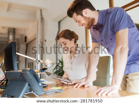 business, startup and people concept - happy creative team with tablet pc computer in office - stock photo